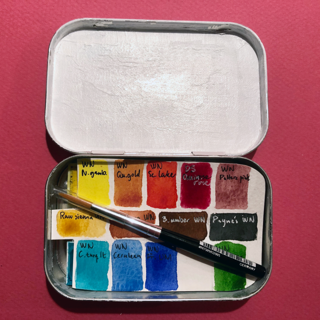 The watercolor travel kit complete with brush and swatched colors